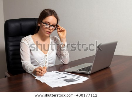 Smart woman boss is going to do her bussiness work sitting on the chair