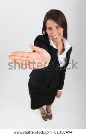 Smart woman showing the palm of her hand - stock photo