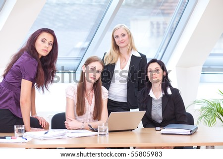 smart women in business outfit sitting at the desk