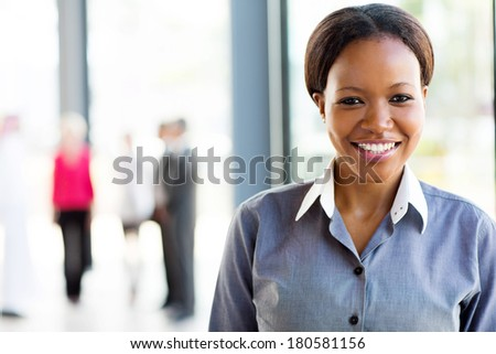 smart young african american business woman in modern office - stock photo