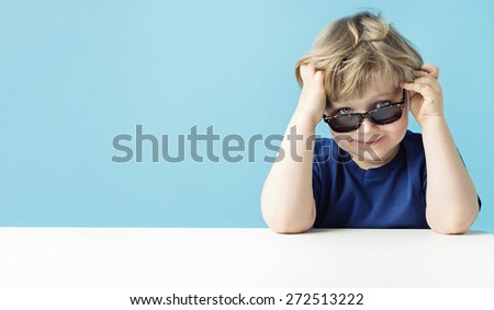 Smart young boy in sunglasses - stock photo
