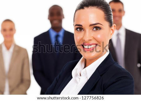 smart young businesswoman and team in studio - stock photo