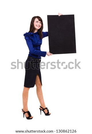 Smart young woman holding a blank board ready for your text.  Isolated on white background in full length. - stock photo