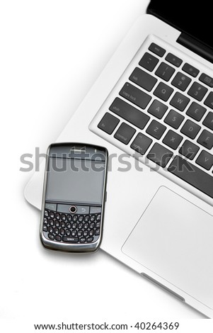 Smartphone and a laptop computer isolated on white background - stock photo