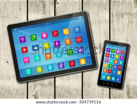 Smartphone and digital tablet PC with desktop icons on a white wood table - horizontal office mockup - stock photo
