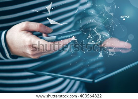 Smartphone and tablet data synchronization, woman syncing files and documents on personal wireless electronic devices at home, selective focus with shallow depth of field. - stock photo