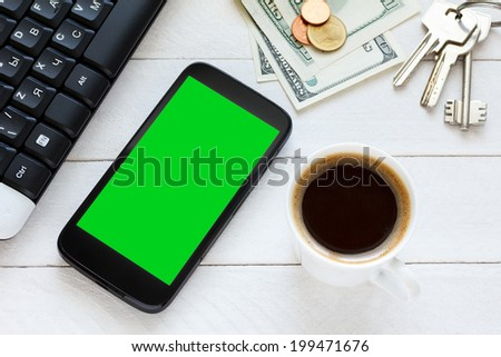 Smartphone cellphone with blank chroma key screen on wooden table - stock photo