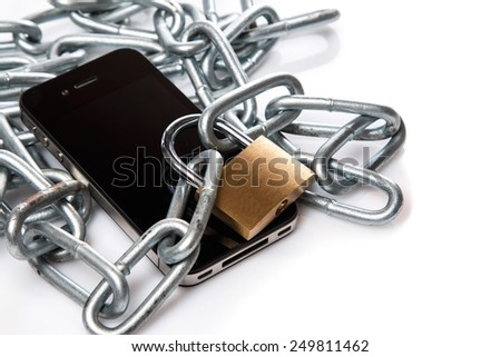 Smartphone, chain and padlock on white background