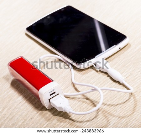 Smartphone charged by power-bank.