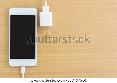 smartphone connect charger and free space for text - stock photo