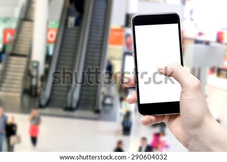 smartphone in hand and a crowd of people - stock photo