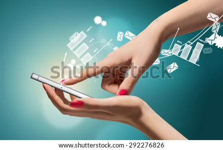 Smartphone in hand on hi-tech background. Communication and technology concept - stock photo