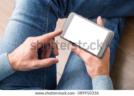 Smartphone in man's hands. View from above. Clipping path included. - stock photo