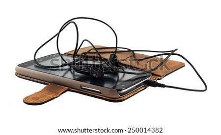 Smartphone in the case with headphones on a white background - stock photo