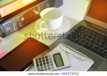 smartphone, laptop and other office tools.