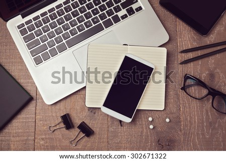 Smartphone mock up template on office deck. View from above - stock photo