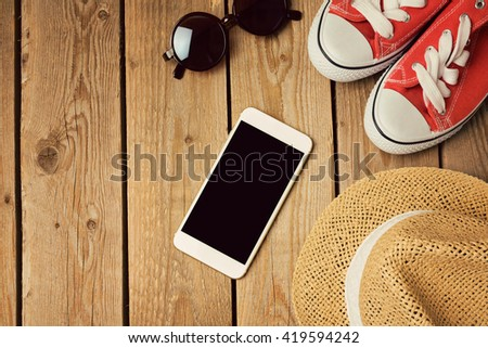 Smartphone mock up template with sneakers and hipster sunglasses. View from above. Flat lay - stock photo