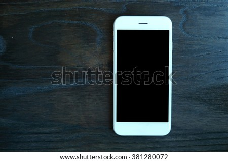 smartphone on wooden background - stock photo
