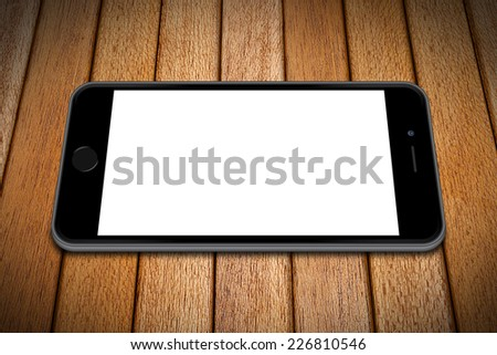 Smartphone on wooden table, iphon style. - stock photo