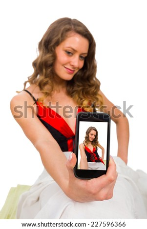 Smartphone used for bedtime sexting by hot chick. - stock photo