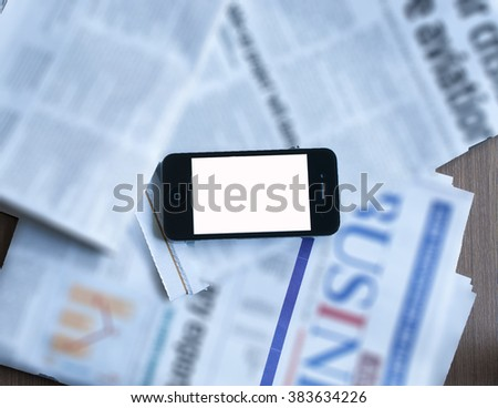 Smartphone with blur newspaper background - stock photo