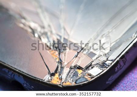 Smartphone with broken screen. - stock photo
