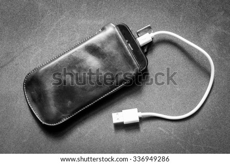 Smartphone with charger