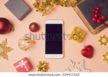 Smartphone with Christmas decorations. Christmas mock up template. View from above - stock photo