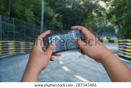 Smartphone with GPS navigator on map. - stock photo