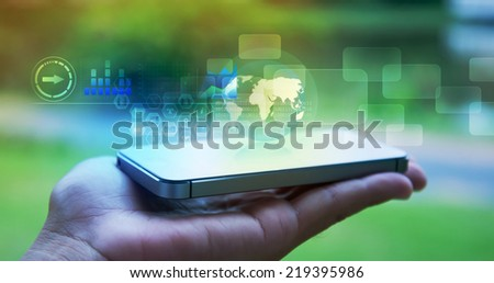 smartphone with technology concept on hand - stock photo