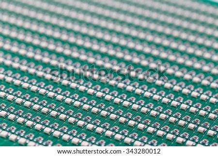 SMD LEDs on Green PCB (Printed Circuit Board), LED lighting, Illumination Elements for Electronic Devices and Industrial Applications, LED Technology Background - stock photo