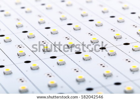 SMD LEDs on White PCB, Commercial and Industrial LED Light Production, Illumination Elements for Electronic Devices and Industrial Applications - stock photo