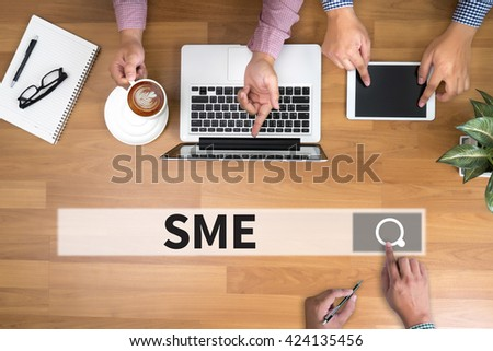 SME or Small and medium-sized enterprises man touch bar search and Two Businessman working at office desk and using a digital touch screen tablet and use computer, top view - stock photo