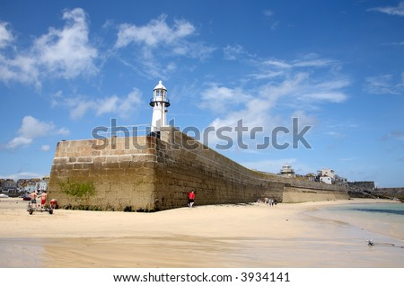 Smeaton's pier in St. Ives, Cornwall, at low tide. - stock photo
