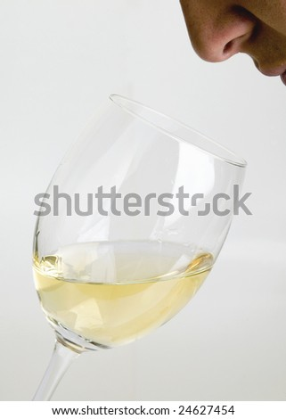 Smelling the white wine - stock photo