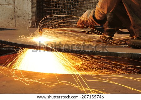 Smelting industry sparks in steel mills   - stock photo