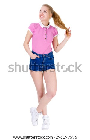 Smile and happy young teenager blonde girl with white teeth in shorts and t-shirt looking to side, isolated on white background, positive human emotion, facial expression - stock photo