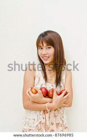 smile asian girl and apples in her arm