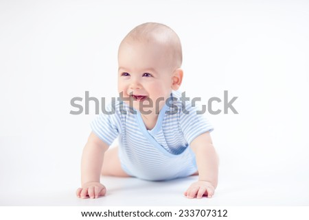 Smile baby in blue - stock photo