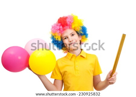 Smile boy in clown wig with balloons and party poppers, isolated on white background - stock photo