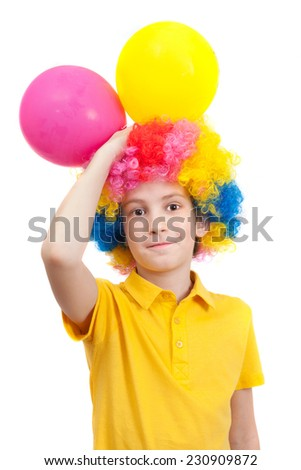 Smile boy in clown wig with two balloons, isolated on white background - stock photo