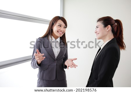 smile business woman team speak to her workmate office, asian - stock photo