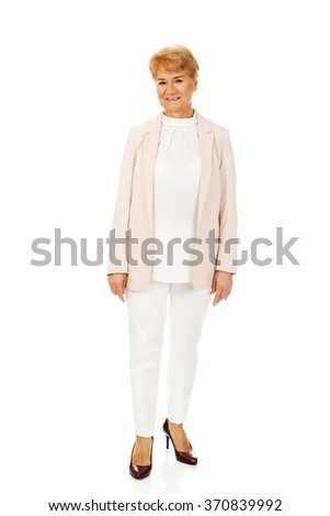 Smile elegant senior blonde woman - stock photo