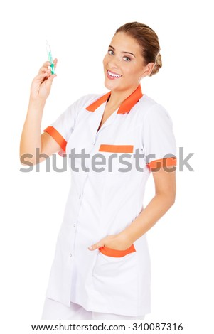 Smile female nurse or doctor with a syringe in hand. - stock photo