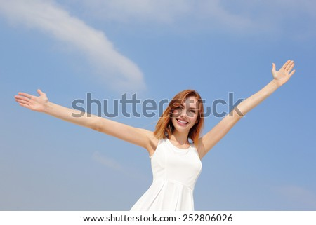 Smile Freedom and Carefree woman. She is enjoying nature during travel holidays vacation outdoors. caucasian beauty - stock photo