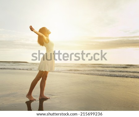 Smile Freedom and happiness woman on beach. She is enjoying serene ocean nature during travel holidays vacation outdoors. asian beauty - stock photo