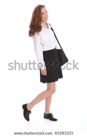 Smile from beautiful teenage secondary school student girl wearing black and white school uniform, holding on to her bag. - stock photo