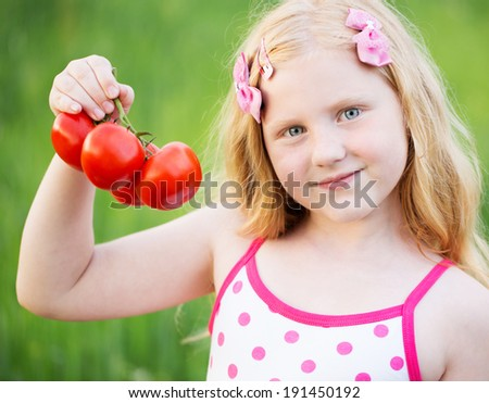 smile girl with tomatoes - stock photo
