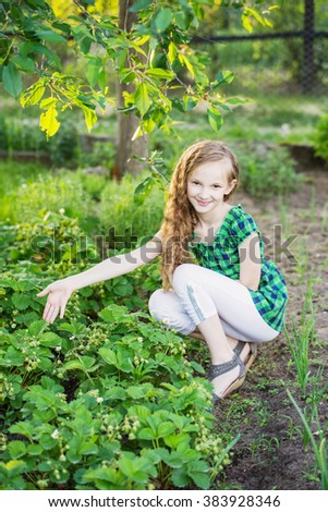 smile girl work in a garden - stock photo