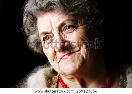 Smile granny face on a black background